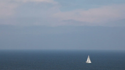 Sailing boat in open blue sea, top view ビデオ