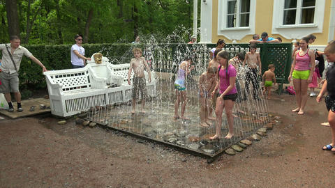 Children under the jets of the fountain. Peterhof. Footage
