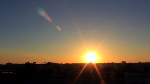 Timelapse of city sunset with silhouette of buildi Footage