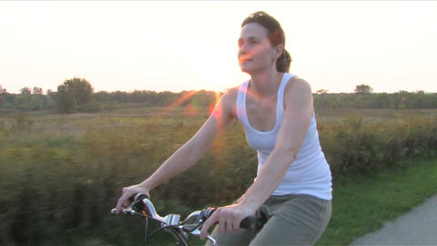 Woman On Bike Ride 3 stock footage