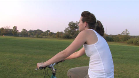 Woman On Bike Ride 1 stock footage