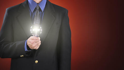 Businessman Holding Light Bulb stock footage