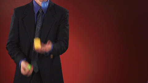 Man in Suit Juggling Footage