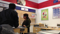 Couple mailing letter at post office Footage