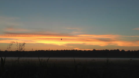 hot-air balloon over landscape during sunrise Footage