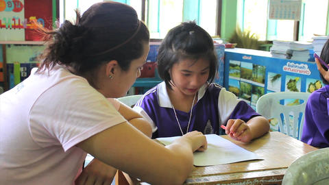 Missionary Teaching English To Asian Female Studen Footage