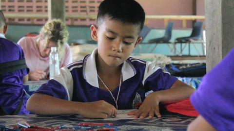 Asian Boy Enjoying Coloring During English Class Footage