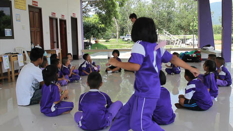 Missions Team Playing Fun Game With Asian Children Footage