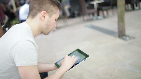 Student playing with electronic device Footage