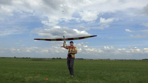 Man Launches RC Glider in the Sky, on blue sky bac Footage