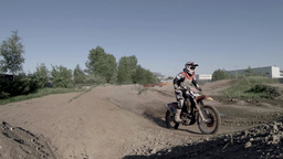 Motocross racer jumping on a motorcycle sequence Live Action