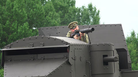 The gunner is shooting from an armored car. The fi Footage