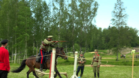 Russian soldier riding a horse and shoots. WWI. 4K Footage
