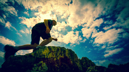 Man Stride Through Deep On Dramatic Clouds Backgro stock footage