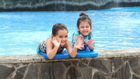 Two little girls In Swimming Pool Footage