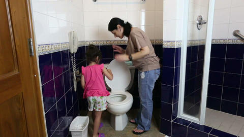 mother teaching her baby to use the toilet Footage