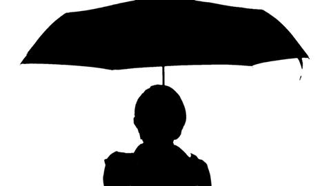 Black and white image of a woman with umbrella Live Action