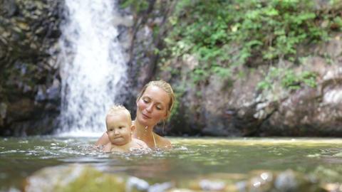 mom jump baby waterfall Footage