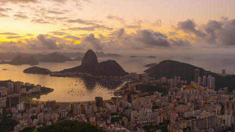 Sunrise time-lapse of Sugar Loaf mountain from behind Rio Footage