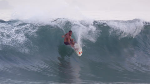 A surfer catches a wave on a short board off the coast of Rio de Janeiro, Brazil Footage