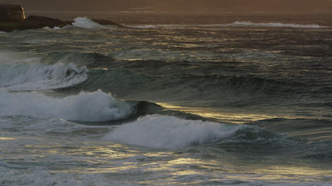 Tilting shot of waves breaking on Ipanema beach at sunset Footage