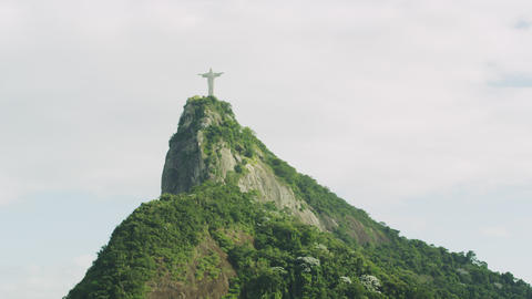 Slow pan of Christ statue and mountain Footage