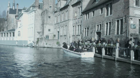 People Sit In A Boat On The River. Bruges, Belgium stock footage