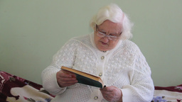 An old woman is reading a book 2 Live Action