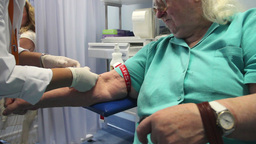 Old woman have a blood test at medical laboratory Footage