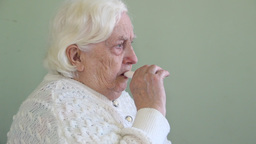 Old woman inhales medicine for asthma Footage