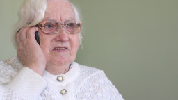Old woman talking on a mobile phone Live Action