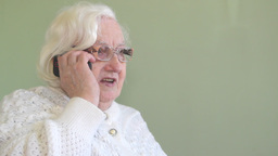 Old woman talking on a mobile phone 2 Footage