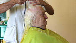 Hairdresser - old woman having her haircut Footage