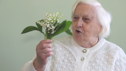 An old woman is receiving flowers Footage