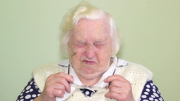 Old woman has problem with eyes Live Action