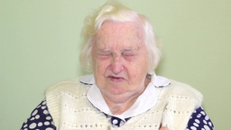 Old woman has problem with eyes Stock Video Footage