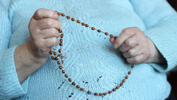 Old, Catholic Woman Praying The Rosary stock footage