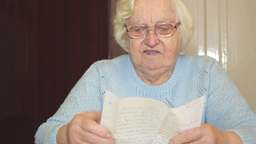 Senior Woman Reading Letter. 1 stock footage