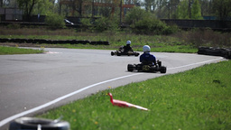 Race Go-kart in a curve rear view Live Action