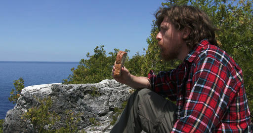 Hiker resting and eating a sandwich Footage