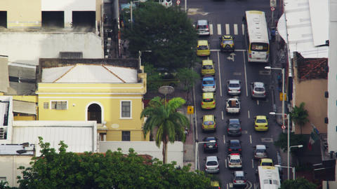 Looking down at cars moving across Rio intersection Footage