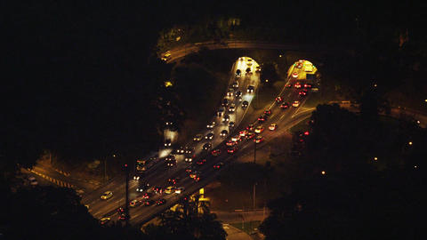 Cars driving in and out of tunnels at night Footage