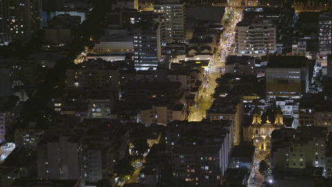 Time-lapse shot of downtown Rio De Janeiro at night, traffic driving down a main Footage