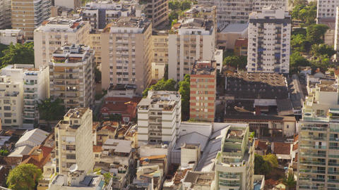 Summer in the city tilt shot of Rio de Janeiro's architecture Footage