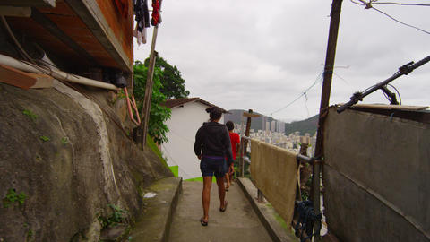 Slow dolly shot of walking kids in a favela on June 23, 2013 in Rio de Janeiro,  Footage
