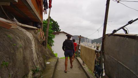 Slow Dolly Shot Of Walking Kids In A Favela On Jun stock footage