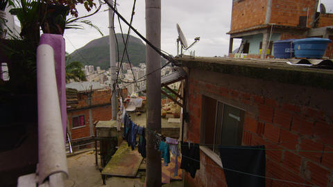 Slow motion tracking shot of apartments in a favela in Rio de Janeiro, Brazil Footage