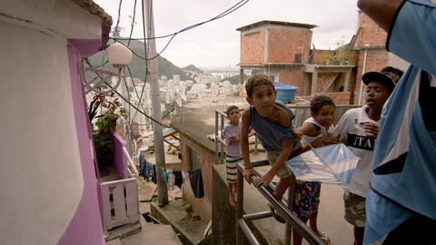 RIO DE JANEIRO, BRAZIL - JUNE 23: Slow dolly shot, favela occupants on Jun 23, 2 Footage