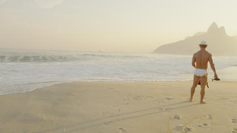 Man waits on Ipanema beach Footage