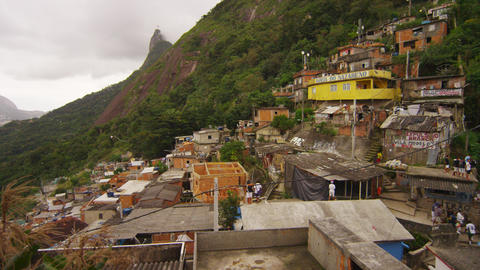 RIO DE JANEIRO, BRAZIL - JUNE 23: Slow pan over a favela community and a soccer  Footage